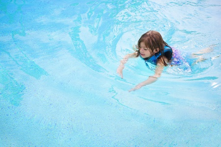 Child learning to swim (Lots of Copy Space) Stock Photo - 9785343
