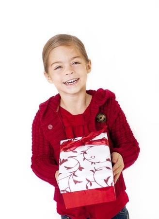 Little Girl holding her Christmas Present Stock Photo - 12035951