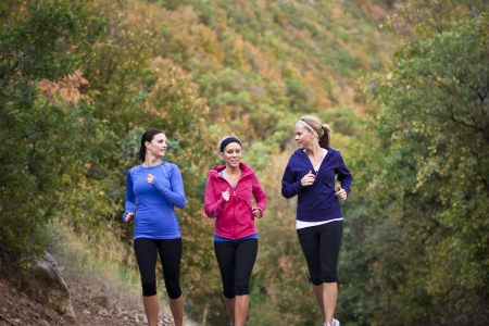 slender woman: Group of Women Jogging Together Stock Photo