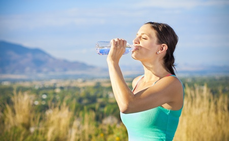 Fitness woman drinking water after workout Stock Photo - 12037842
