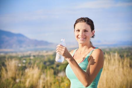 water aerobics: Beautiful Fitness Woman Drinking Water Stock Photo
