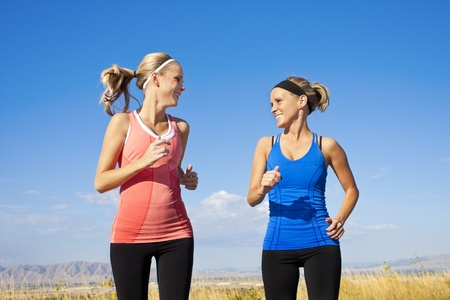 Two beautiful Women Jogging Together Stock Photo - 12035945