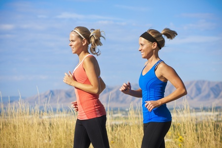 Female Runners on a jog outdoors (side view) Stock Photo