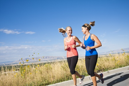 mid thirties: Two Beautiful Female Joggers