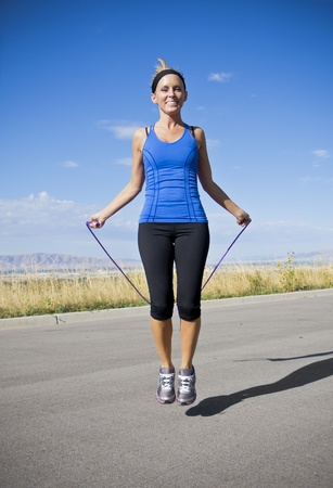 jump rope: Attractive Women Exercising and Jumping Rope