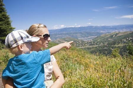 idaho state: Child pointing while on a family hike in the mountains