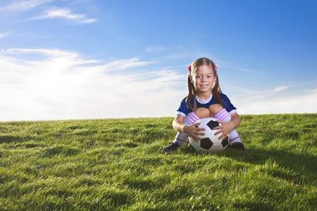 girl kick: Cute little girl soccer player