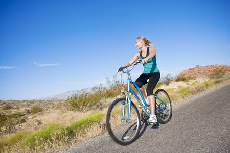 Healthy active Woman on a bike ride Outdoors photo