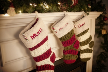Christmas Stockings hanging on the fireplace during the holidays photo