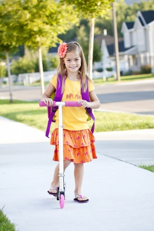 going: Cute little girl going to school
