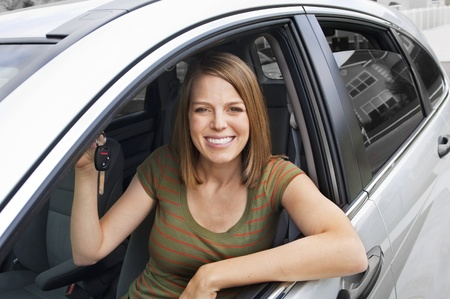 Beautiful Woman ready to drive her new car photo