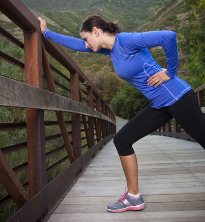 Woman Stretching Before a workout photo