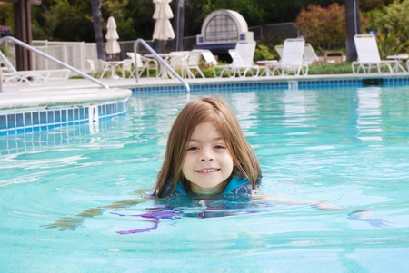life jackets: Cute Little Girl swimming in the Pool