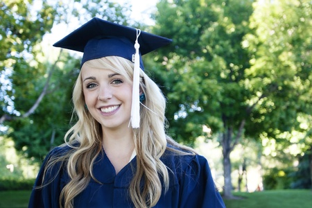 cap and gown: Beautiful Blonde Female Graduate Portrait