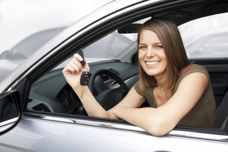 Happy Woman Renting or Buying a Car Stockfoto