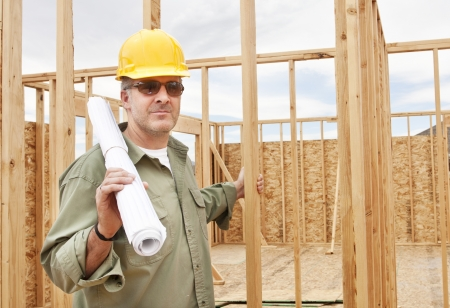 Handsome construction worker building a Home