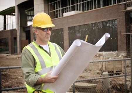 architect plans: Construction Foreman on the Job site Stock Photo