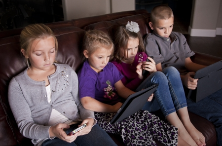 Kids using Mobile Devices photo