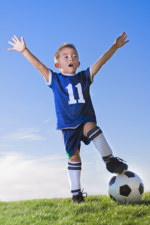 Young Boy soccer player celebrating photo
