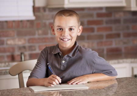 Handsome young man studying and writing photo