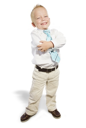 folded arms: Smiling Little Businessman looking confident Stock Photo