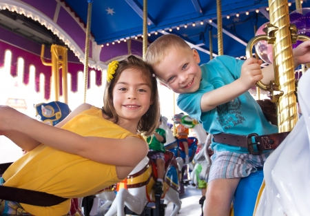 disneyland: Kids having fun on a carnival Carousel