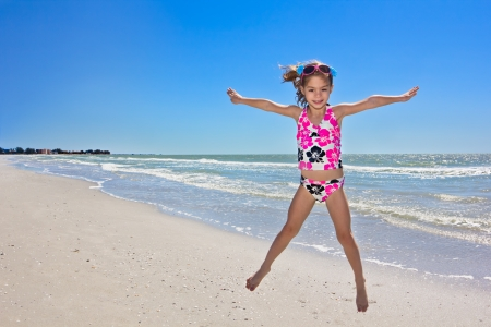 Summer Beach Fun young girl on vacation photo