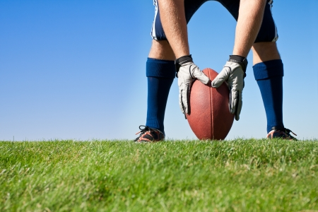 football cleats: Getting Ready for Football Kickoff Stock Photo