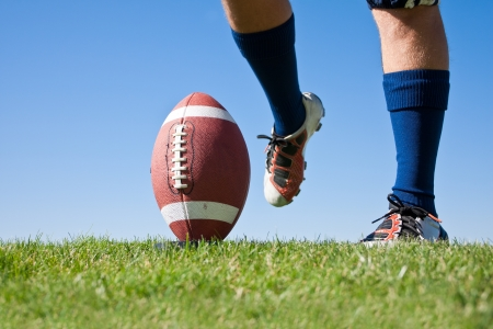 football cleats: American Football Kickoff low angle