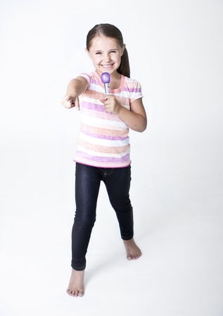 Cute little Pop Star singing on white background Stock Photo - 14346135