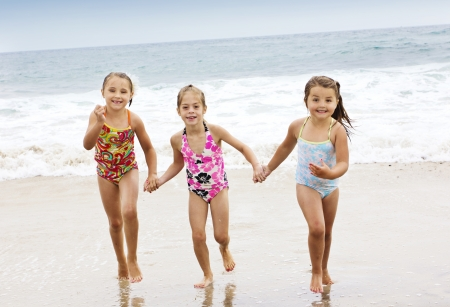 Little kids Playing at the Beach photo