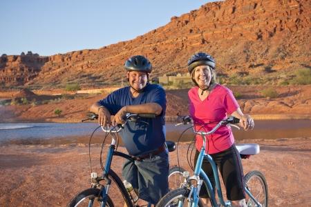 Active Senior Couple enjoying a bike ride together photo