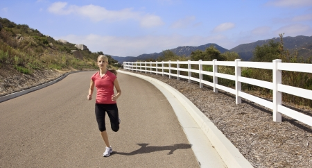 Female Jogger running on the road Stock Photo - 14443139