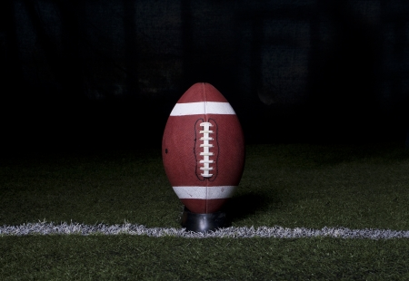 Football Kickoff on night background photo