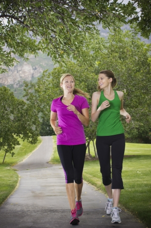 Beautiful Female runners on a path Stock Photo - 15517966