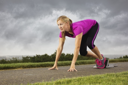 Fit Middle-Aged Female Ready to Sprint Stock Photo