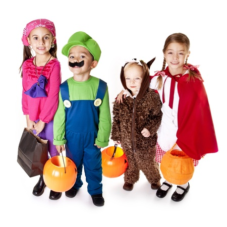 trick or treating: Halloween Trick-or-Treaters in their costumes