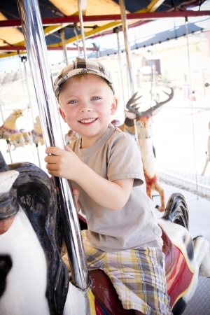 merry go round: Little Boy on a Carnival Carousel