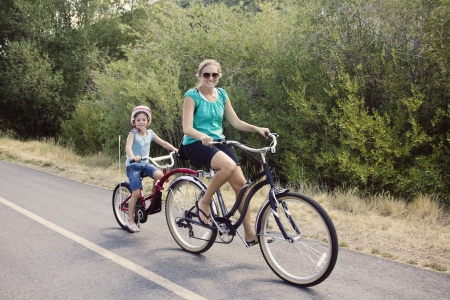 tandem bicycle: Family Enjoying a Bike Ride Stock Photo