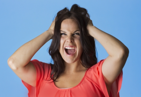 Crazed and Frustrated Woman pulling her hair photo
