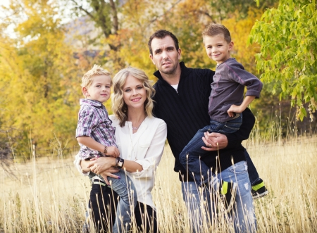 Happy Young Family Portrait with Fall colors photo
