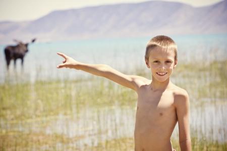 Smiling Boy having Fun at the Lake Summer Vacation photo