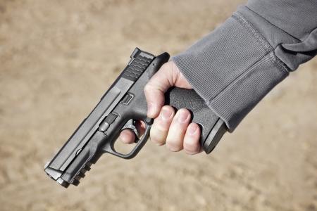 hand gun: Holding a Hand Gun