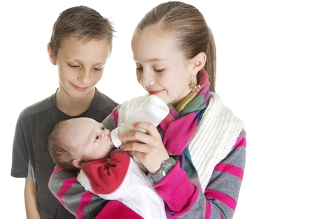 caring for: Siblings Caring for their new Baby Brother Stock Photo