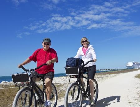 Senior Couple on a bike ride while on cruise vacation photo