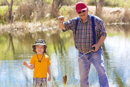 fishing pole: Little Boy and His Grandpa catching a fish