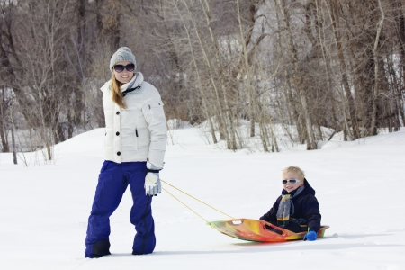 sledding: Family enjoying a day Snow sledding Stock Photo