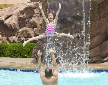 Family Playing in the swimming pool