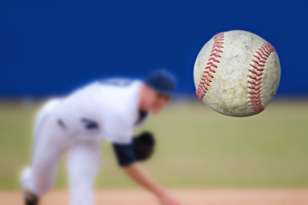 Baseball Pitcher Throwing ball, selective focus photo