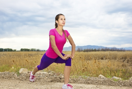 skinny woman: Beautiful Hispanic fitness Woman Outdoors Stock Photo